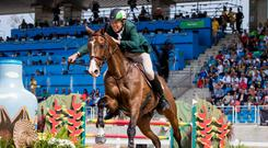 Ireland's Jonty Evans celebrates on Cooley Rorkes Drift after finishing ninth in the Eventing Team Jumping at the Rio Olympics. The horse is a 2010 Goresbridge sales graduate. Photo: INPHO/Morgan Treacy