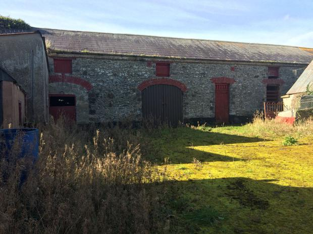 The outbuildings at Mullaghroe include this old coachhouse