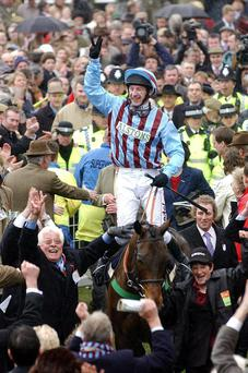 Best Mate, pictured in 2004 with jockey Jim Culloty after completing the three-in-a-row in National Hunt racing's blue riband event