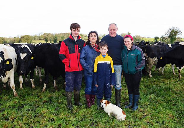 John Sheridan with his wife Anne, sons Matthew, John Jnr, daughter Mary and Benson the dog on their farm in Mostrim, Co. Longford. Photo: Lorraine Teevan