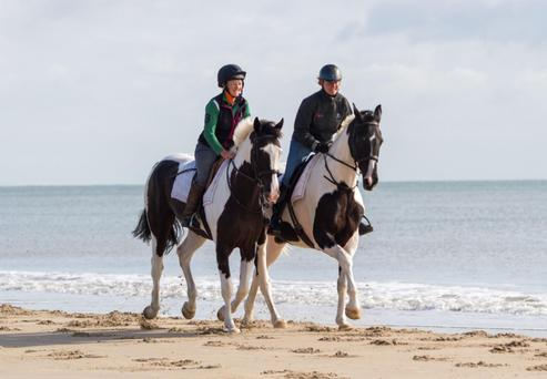 Edie Murray-Hayden (on left) riding Right to Play's Jack Sparrow and Barbara Keller onboard Unicum enjoying a canter along Curracloe Beach in Co Wexford