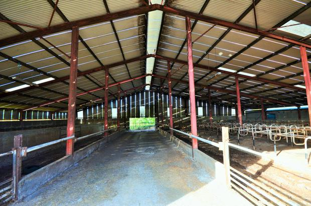 The outbuildings include an 80-cubicle shed