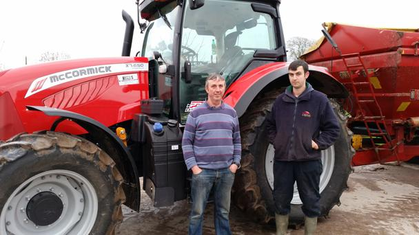 Jerry Fitzgerald, and his son, James, with their new McCormick X7.650
