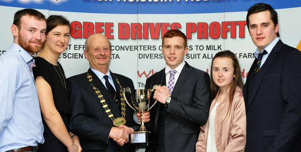Alex Bryan, President, IHFA presenting the YMA Club of the Year Award to Colin Todd, Breffni-Oriel Club, with Auriel Hellen, National Chairperson IHFA YMA, and club members, Edwin Jones, Rachel Corley, and Brendan Grennan.