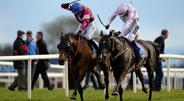 Rogue Angel and Ger Fox (left) on their way to winning the Boylesports Irish Grand National last year