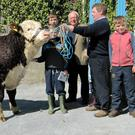 Rory Farrell and family members with their top priced bull Ballinveney Superstar and Nelson McCrabbe, Donegal who purchased the bull for €3,700.