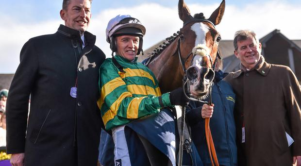 Jockey Barry Geraghty with Jer's Girl, alongside Trainer Gavin Cromwell, left, and Owner J.P. McManus after winning the Tattersalls Ireland Champion Novice Hurdle