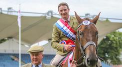 Pat Loughlin and Brian Murphy with the Balmoral-sourced Fort Knocks which won the hunter title at the RDS