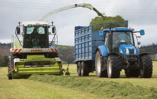 JIm Greene and Padraig Burke of Greene Agri Contractors picking up silage (8 tonne per acre) for Tom O'Donnell and Stephen Leahy on one of the Electric Picnic car park fields at Stradbally, Co. Laois Monday 24 April 2017. Picture: Alf Harvey/HRPhoto.ie