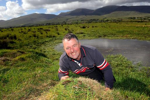 Kerry farmer John Evans beisde a natterjack conservation scheme pond in Keel, County Kerry. Photo: Don MacMonagle