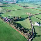 An aerial view of the farm, buildings and residence for sale in Harristown, Co Meath with a guide price of €2m