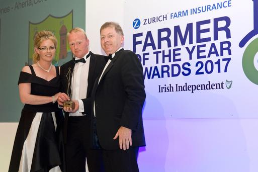 Farmer of the Year winner Peter Hynes, pictured with his wife Paula, as they collect the trophy from Anthony Brennan, CEO of Zurich Ireland