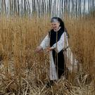 Sr Lily Scullion checking out the miscanthus crop which is being used to heat the Abbey. Photo: Valerie O'Sullivan