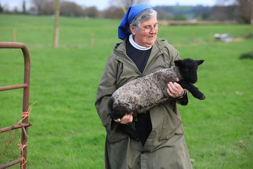 Sr Lily Scullion tending a lamb on the St Mary's Abbey farm in Glencairn, Co Waterford where she has been farm manager for the past decade. Photo: Valerie O'Sullivan