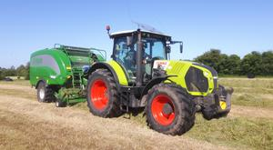 The Fleming Agri combination of a Claas 650 and McHale Fusion 3 hard at it in the field