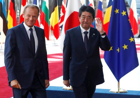 European Council President Donald Tusk with Japan's Prime Minister, Shinzo Abe, at the start of a EU-JAPAN summit in Brussels