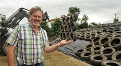 Liam Murphy with his silage pit tyre weight. Photo: Roger Jones