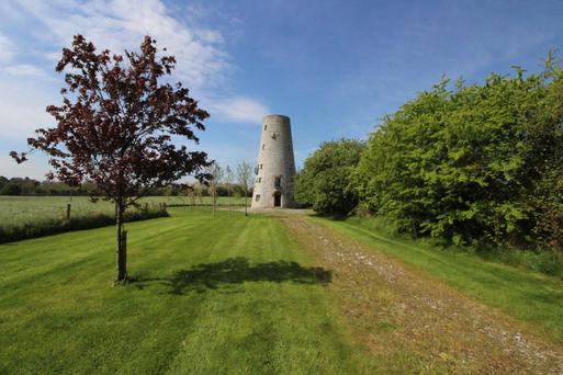 The sale of 25ac near Navan included this five-storey 19th-century windmill which has been converted into a residence