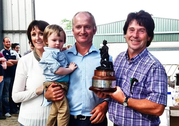 Ann Marie, Eamonn and Thomas Duffy (2) being presented with the Jack Mc Culloch Memorial Trophy for Suffolk Flock of the Year 2017 by Harry Kellett, a former winner of the award, at the Suffolk Society Open Day on the Duffy farm in Kells, Co Meath.