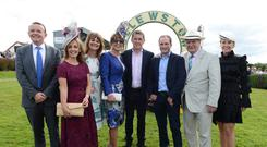 The Dragons with trainer Keith Watson and Tony McCoy enjoying a day's racing at Bellewstown as part of the Horse Racing Ireland 'Experience It' campaign