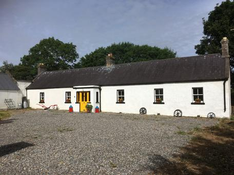 The farmhouse is located at Ballyshannon near Kilcullen and the property comes with outbuildings and two paddocks