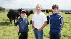 Michael Callinan with his sons Mark and Liam on the farm at Oakdale, Skeagh, Inagh, Co Clare. Photo: Eamon Ward