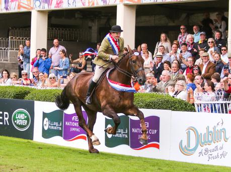 Brian Murphy on a lap of honour aboard the Dublin Horse Show supreme hunter champion Fort Knocks