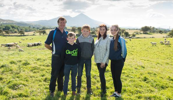 Joe Scahill with his wife Cathy and children Sean, Joseph and Kate on their farm at Sandyhill, Westport, Co Mayo. Photo: michael mclaughlin