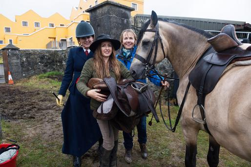 Lucinda Kelly with her mother Avril Kelly and good friend Anna Ruth Duane (holding saddle) at the Connemara Pony Show. Photo:Andrew Downes xposure