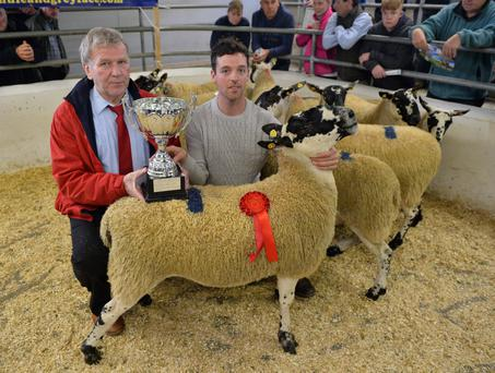 John Morahan from Kilmaine, winner of the best pen of Mule lambs pictured with sponsor TJ Gormley, Cormac Tagging, at the Mayo Mules and Greyface Sheep Breeders Show at Ballinrobe Mart. Photo: Ray Ryan