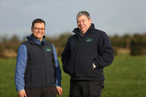 The grassland management targets for Ben Sweeney's farm in Enfield, Co Meath include closing 15pc of his fields per week, commencing on October 10. Ben is pictured here with Teagasc Green Acres programme advisor Gordon Peppard. Photo: Gerry Mooney