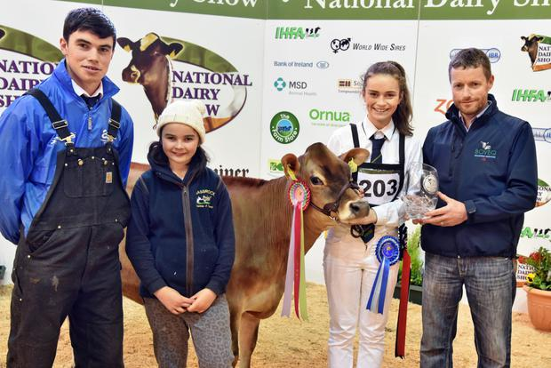 Eimear Lehane, Burrane, Timoleague, Bandon, Co. Cork receiving the trophy for the highest Jersey EBI, Massrock JE2019 Lilley from David Sheehy, with Conbor and Kate Lehane