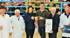 Robert McGivern, Carrigtwohill, exhibitor of the Supreme Champion of the show, receiving the trophy from Sinead Corkery, Bank of Ireland, Kanturk sponsors, with judges Michael Fox, Benny Merrigan and Patrick Hally and Chairman of Kanturk Mart, John Cott.
