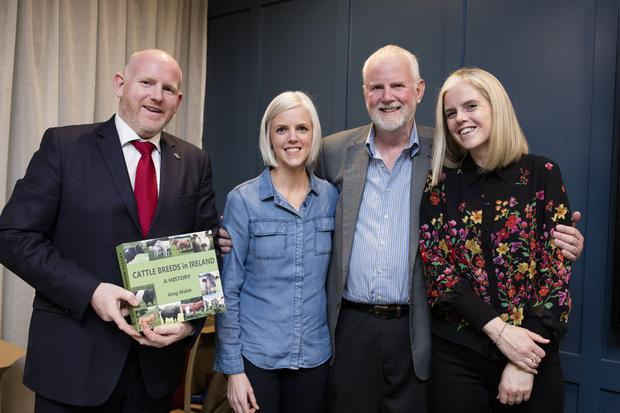 Greg Walsh with his son Dick (left) and daughters Gemma and Claire at the book launch