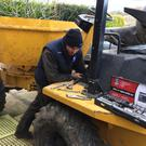 Jamie at work on the three-ton dumper