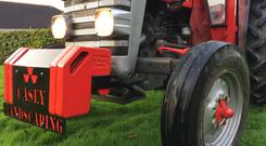 Willie Wilson bought and refurbished the Massey Ferguson 135 tractor. Stock image.