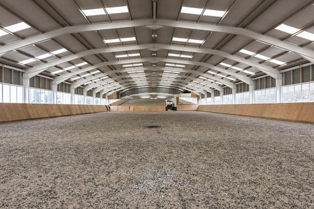 The stables is adjoined by a massive indoor arena.