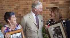 The Prince of Wales meets sisters he boarded with when he was 17 (Arthur Edwards/The Sun)