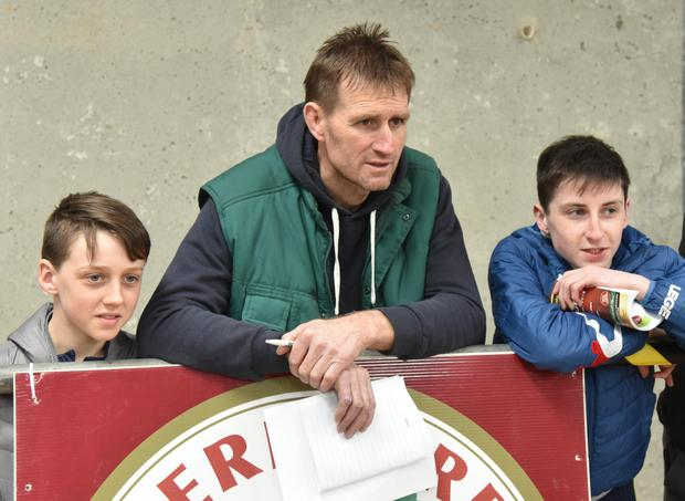 Sean Healy, Glin, Co Limerick with his sons, Aidan and Cormac watching the judging at the Hereford Cattle Society Premier Bull Show and Sale at Tullamore.