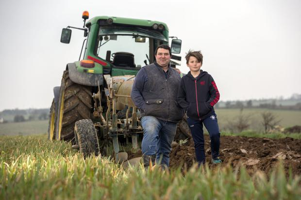 Brian O'Regan and son Patrick on their tillage farm in Dunderrow, Kinsale, Co Cork. Photo: Clare Keogh