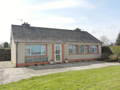 The neat bungalow on the farm was built in 1972 and is described by the auctioneer as being in very good condition
