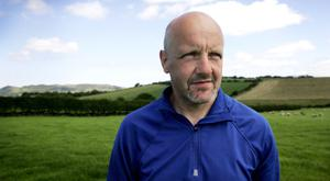 Michael Duffy on his farm in Kerrykeel, Co Donegal; (inset below) Michael testing the silage crop.