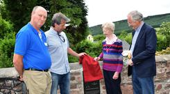 Sorcha Flannery (niece of Dr Henry Kennedy) unveiling the plaque at Toor with Michael Kennedy (Irish Kennedy Heritage Group), Jack Kennedy (grand-nephew) and Michael Berkery (chairman, FBD trust).