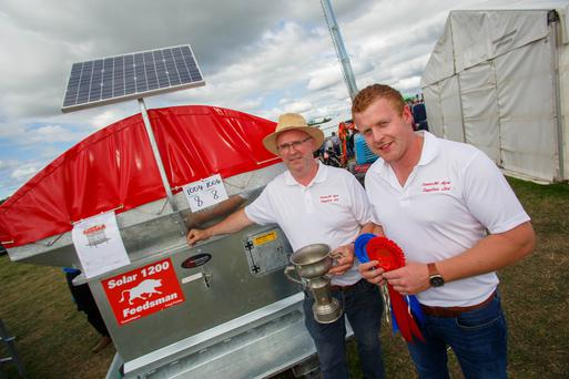 Seamus Hession and Shane Fitzpatrick (Coilmore, Mayo) of Connacht Agri Supplies with their product, a solar powered feed system which won the Inventions in Agriculture, Horticulture & Forestry at the National Inventions Competition at the Tullamore Show and FBD National Livestock Show. Picture: Jeff Harvey