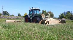 A Fendt 820 equipped with double Krone mowers