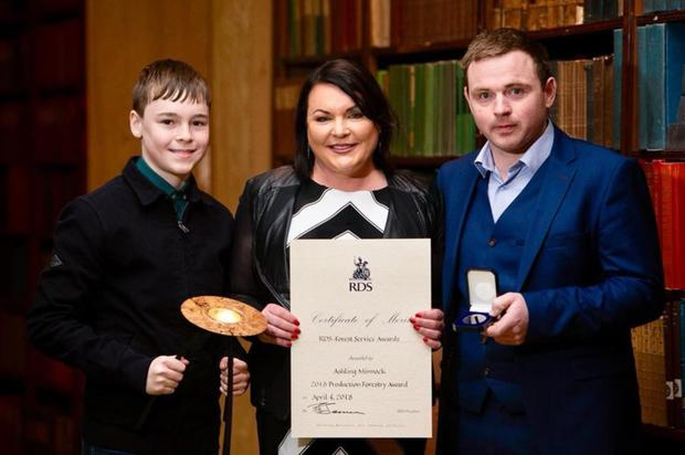 Ashling Foy Minnock, winner of the RDS-Forest Service 2018 Production Forestry Award with her son TJ and Denis Hennessy (forest works & machine manager).