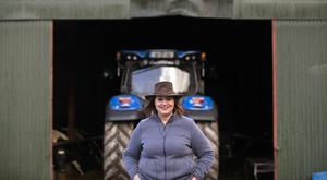 Lucy Hagerty with the New Holland tractor on the family farm in Ballinspittle, Co Cork. Photo: Clare Keogh