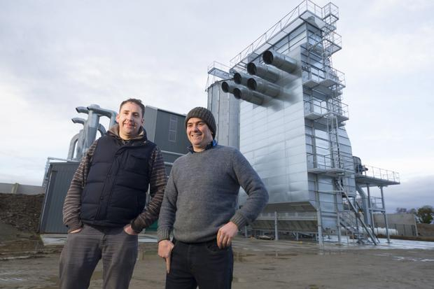 Andrew and Raymond Kavanagh pictured beside a grain store and dryer at the proposed location of the new flour mill in Ballycarney, Co Wexford. Photo: Patrick Browne
