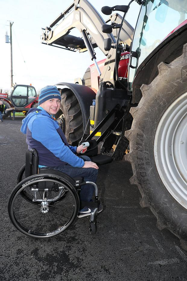 Disabled farmer Martin Murphy has adapted his tractor with a hoist/winch and automated controls in the cab to allow him to keep working.