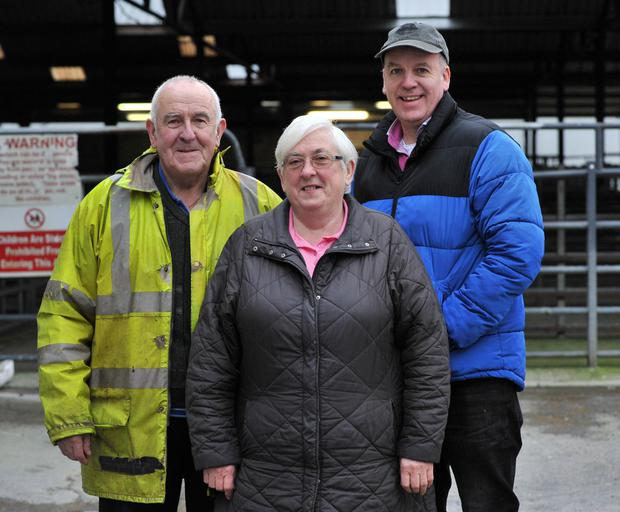 John and Mary O'Reilly from Moycullen with Auctioneer Pat Burke at Headford mart cattle and sheep sale. Photo: Ray Ryan.